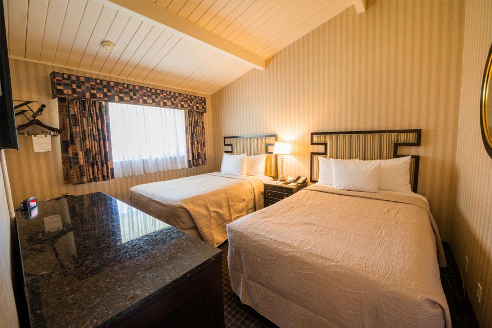 Garden View Two Double Bed Suite | Bedroom
